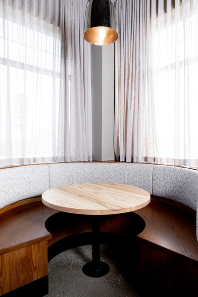 Restaurant tables and booth by Edgework Creative