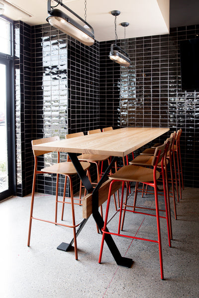Restaurant community table by Edgework Creative