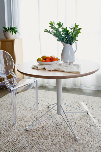 The Mast Dining Table by Edgework Creative, round dining table