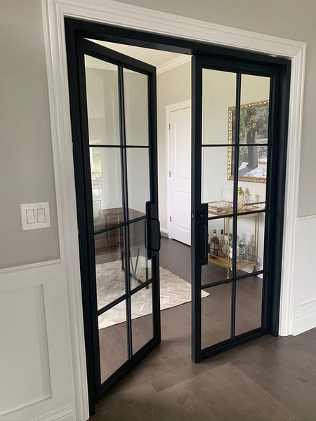 Metal and glass doors by Edgework Creative