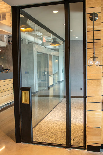 Metal and glass office doors by Edgework Creative