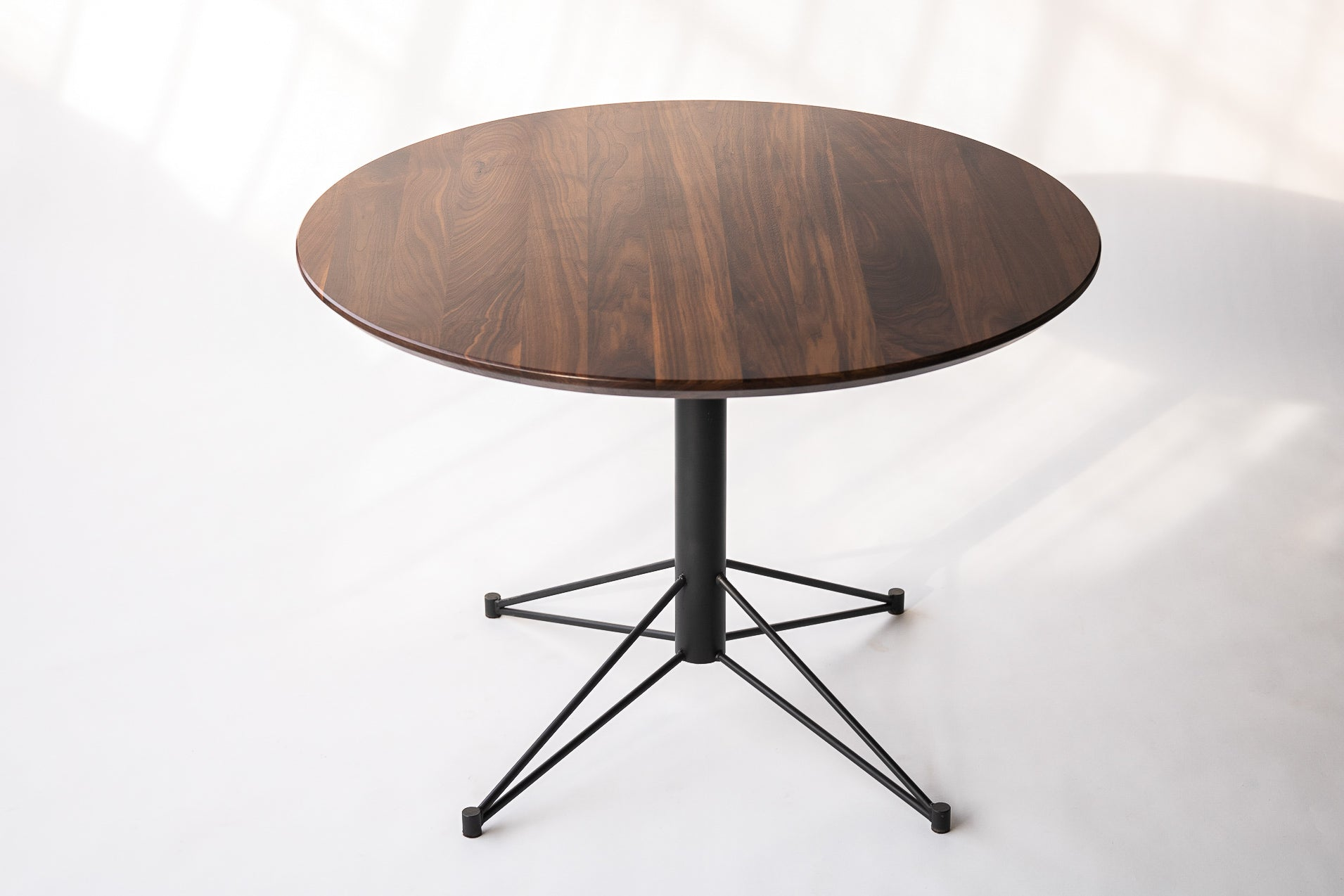 The Mast Table - Round Dining Table with Metal Base by Edgework Creative