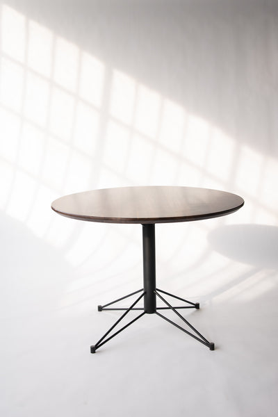 Round dining tables by Edgework Creative