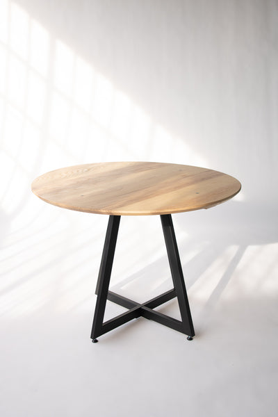 Wood and metal dining table by Edgework Creative