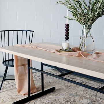 Truss dining table by Edgework Creative, wood and metal table