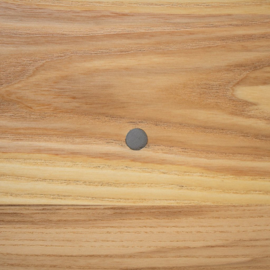 wood table top with metal inlay details