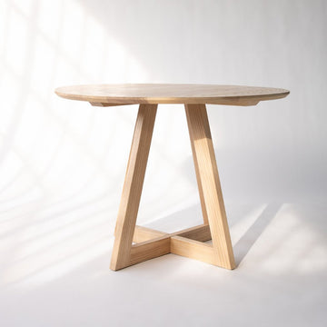 round wood kitchen table with geometric base