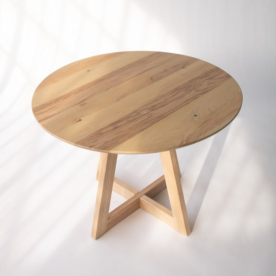 small round ash table top with wood base