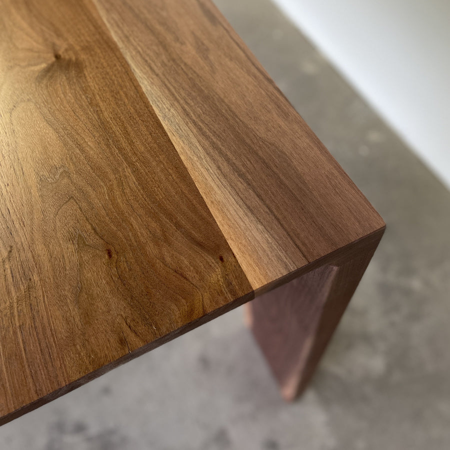 Walnut Lumi dining table by Edgework Creative