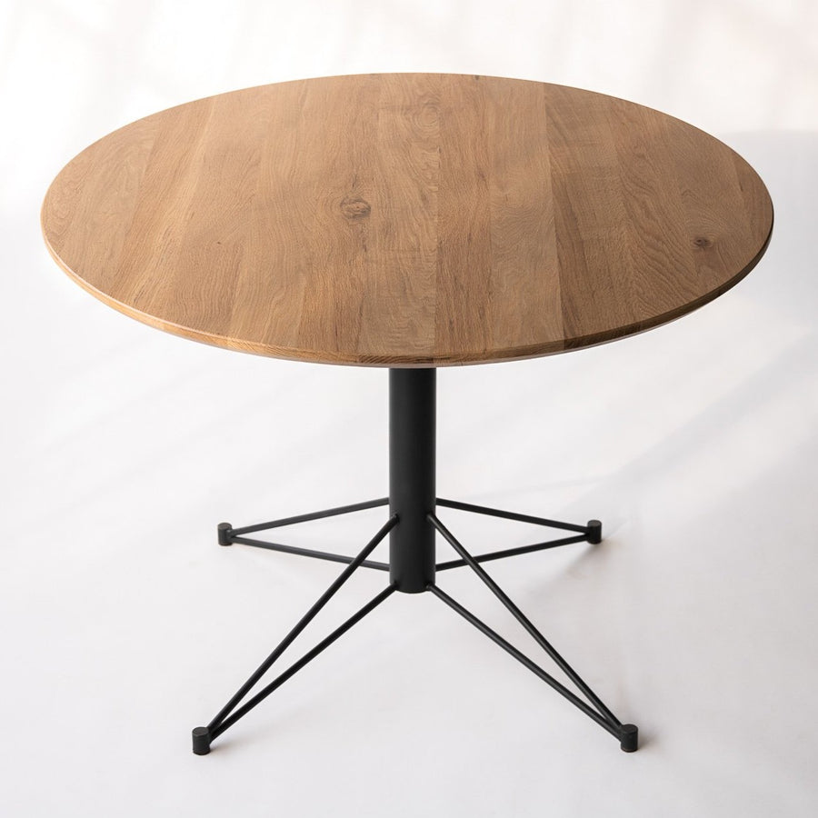 small round dining table with metal base