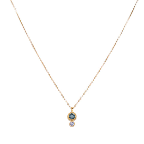 Frida gold necklace, tanzanite, london blue topaz, necklace on white background