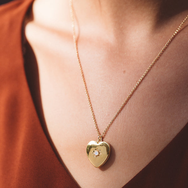 gold locket, heart locket, necklace on chest, necklace with shirt