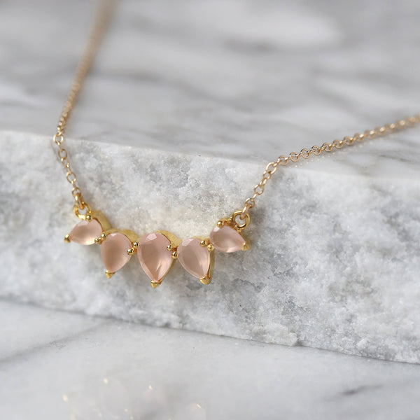 sunny necklace, pink chalcedony, jewelry on marble
