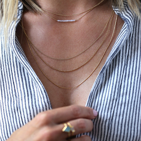 Layercake Necklace, gold, blue striped shirt, layered necklaces, blonde hair