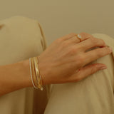 Leah Alexandra gold pearl layering bracelets arm party