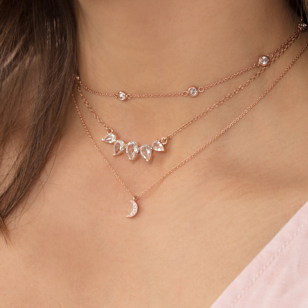 sunny white topaz rosegold necklace, layered necklaces, brown hair, pink top