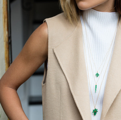 Celeste Emerald Necklace, layered necklace, beige cardigan, white top, blonde hair