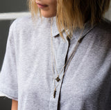 Celeste Black Onyx Necklace, Gold, Grey collared shirt, blonde hair, long necklace, layered necklace