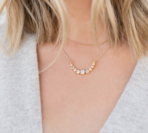 Rainbow Moonstone Necklace, gold necklace with grey sweater, blonde hair
