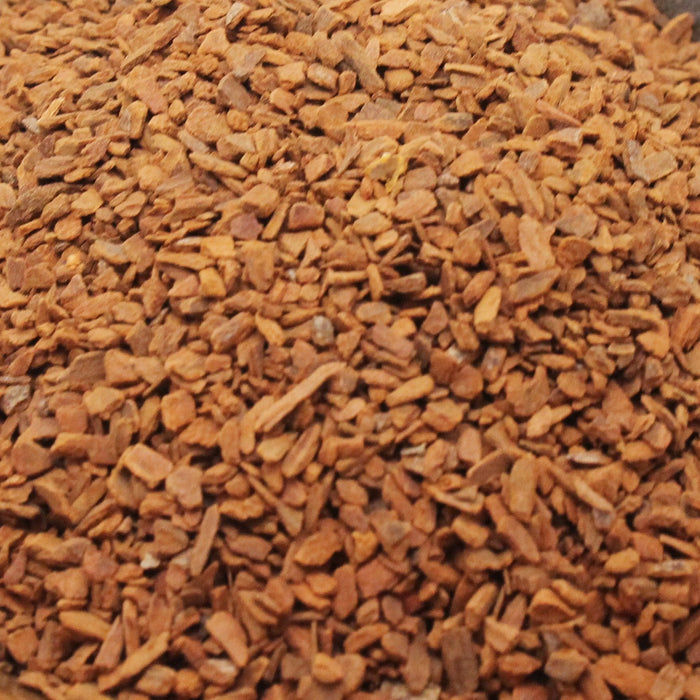A closeup of loose Cinnamon (Cassia) Chips
