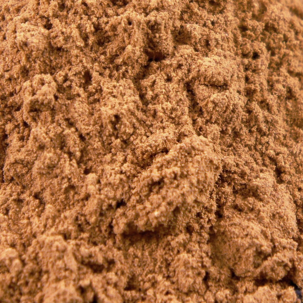 A closeup of loose Cinnamon (Cassia) Powder
