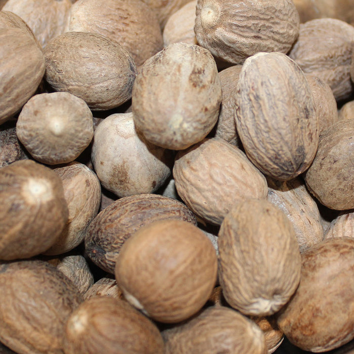 A closeup of loose Nutmeg (Whole)