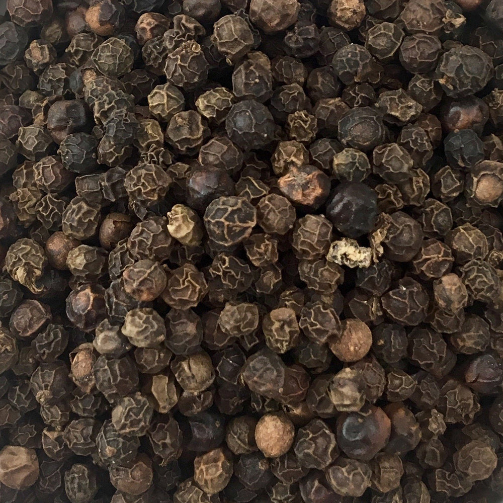 A closeup of loose Peppercorn (Black)