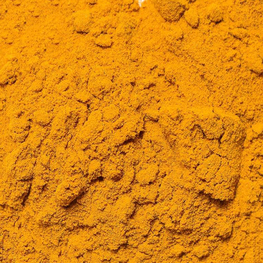 A closeup of loose Turmeric Root Powder