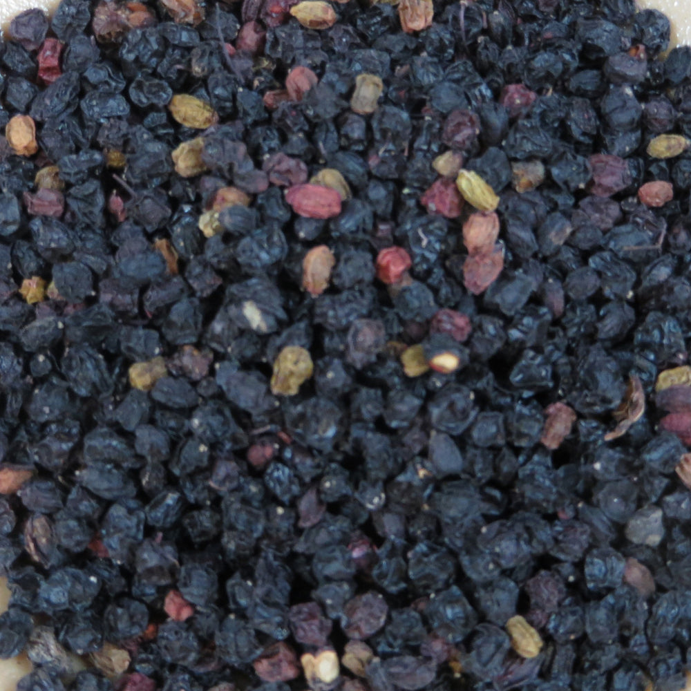 A closeup of loose Elderberries