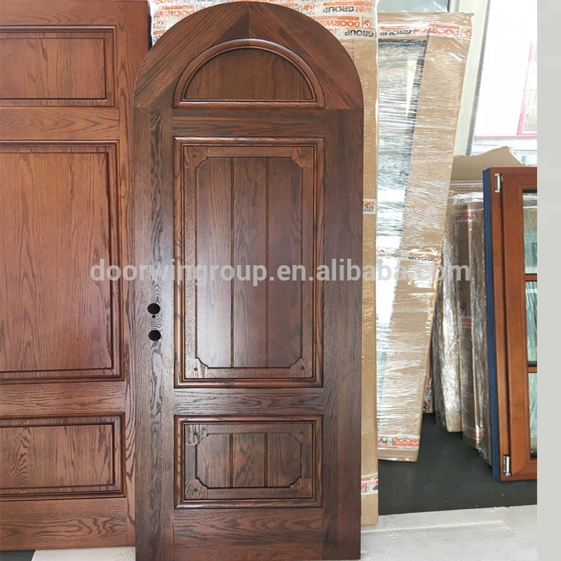 China cheap arched exterior double wood door by Doorwin on Alibaba