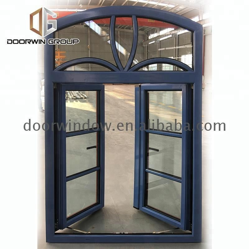 Double glass arched design window iron grills decorative metal by Doorwin on Alibaba