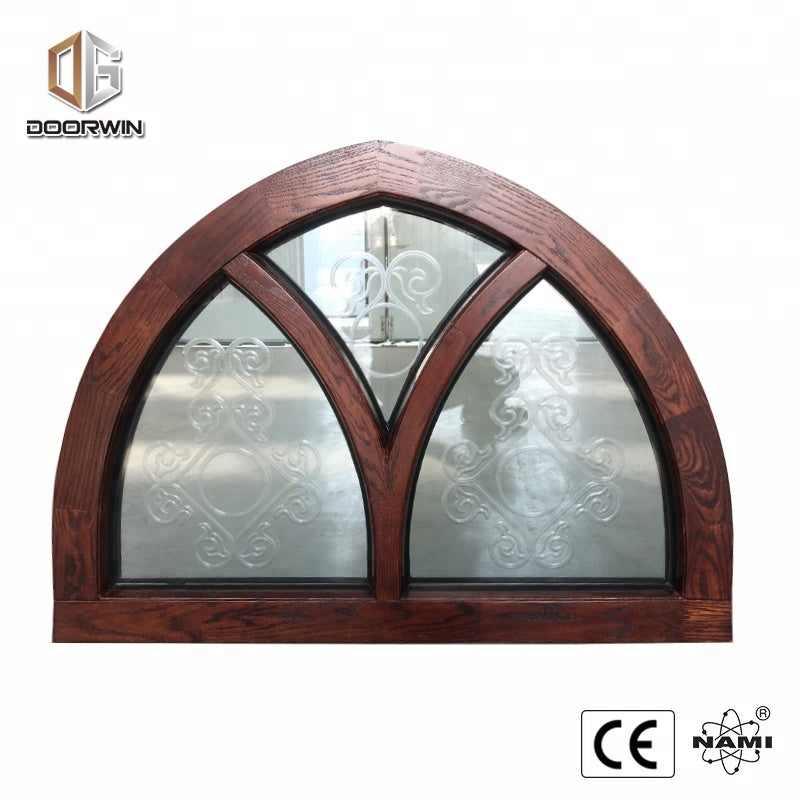 Fantastic arched oak wood window frame with carved glass for houseby Doorwin