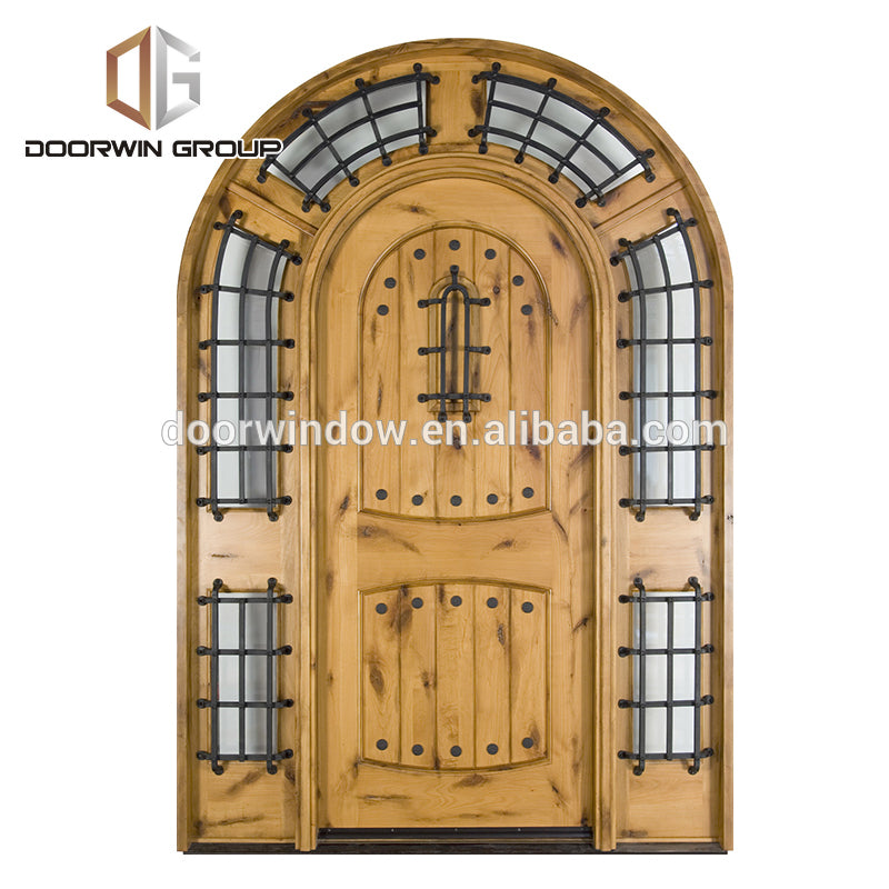 Home entrance door outside front doors with decorative wrought iron clavos by Doorwin