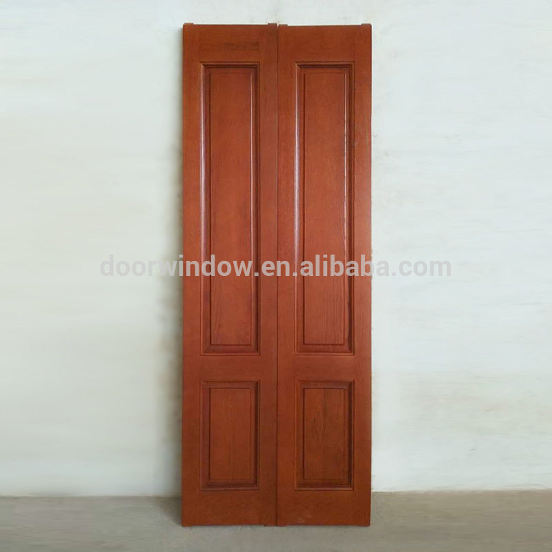 Luxury interior wood door solid hardwood finger joint wood board with oak veneers red color folding storm door for apartment by Doorwin