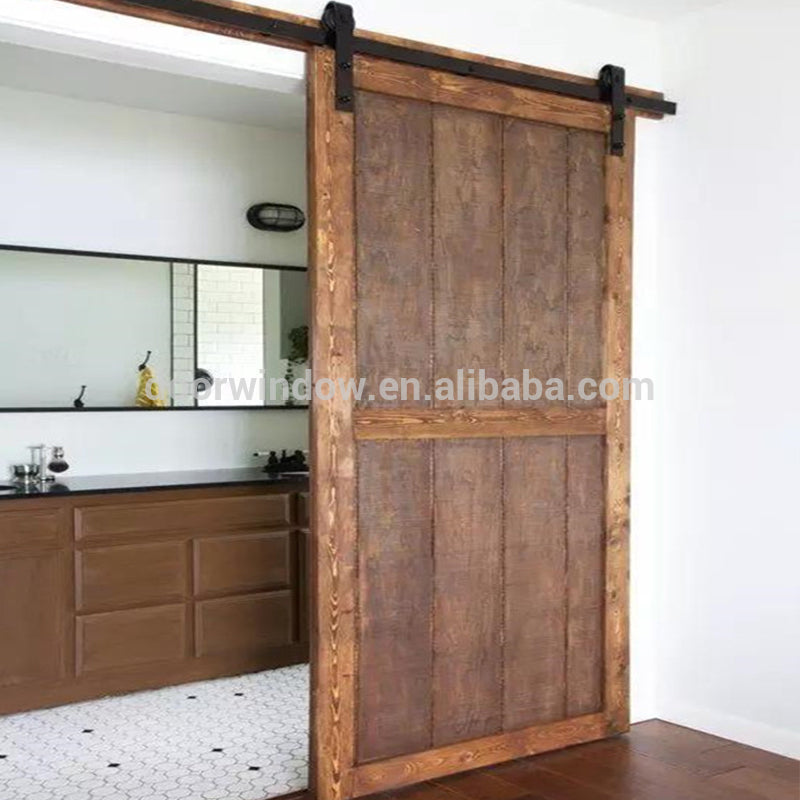 Movable plank panel wooden doors design catalogue surface stained sliding barn door for partition by Doorwin