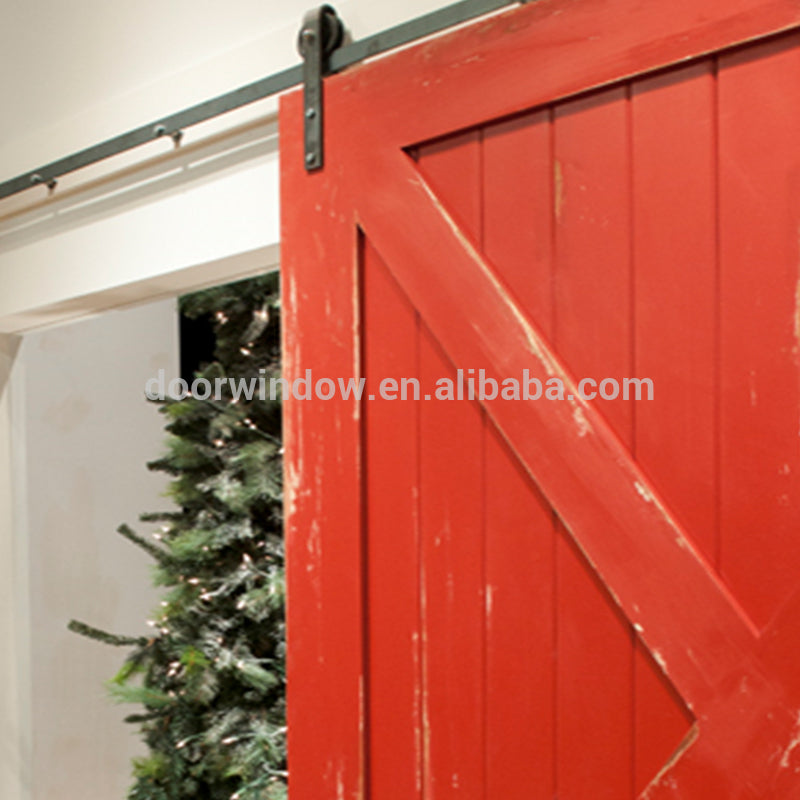 Nice looking American sliding barn door X type made of pine wood by Doorwin
