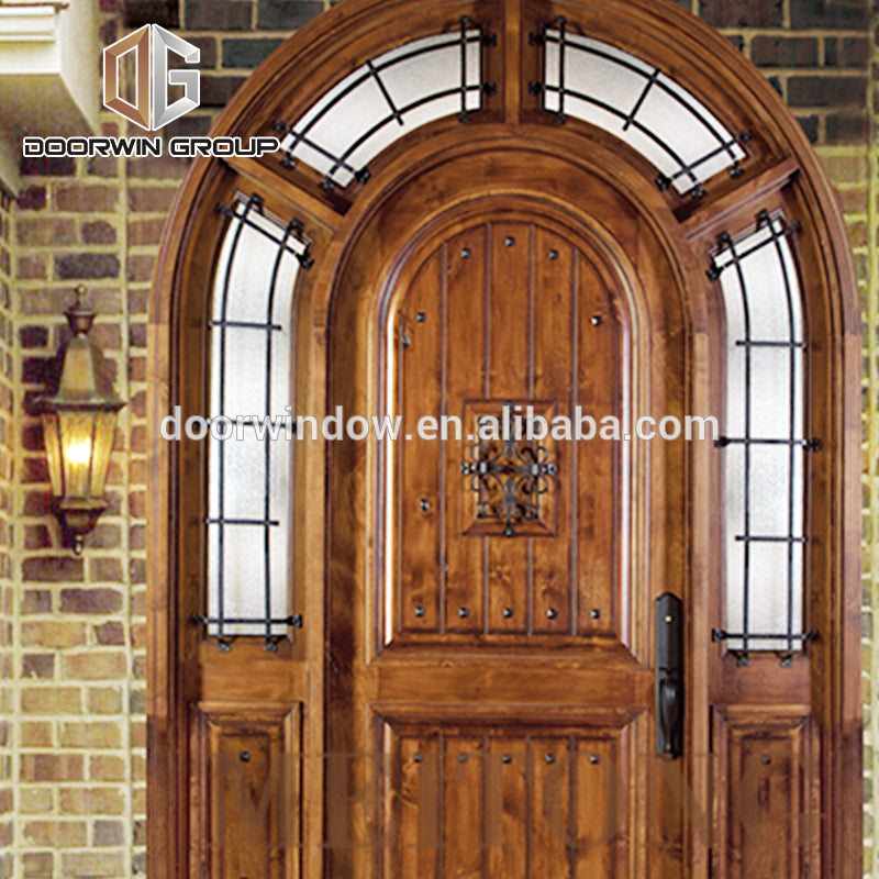 North America popular front french doors round top design with decorative wrought iron clavos by Doorwin