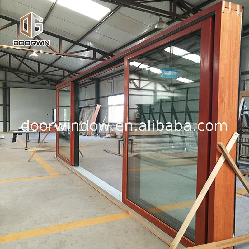 Used commercial glass doors teak wood front door design swing by Doorwin on Alibaba