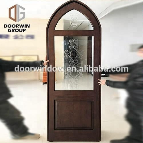 arch main door design antique solid wood exterior doors by Doorwin