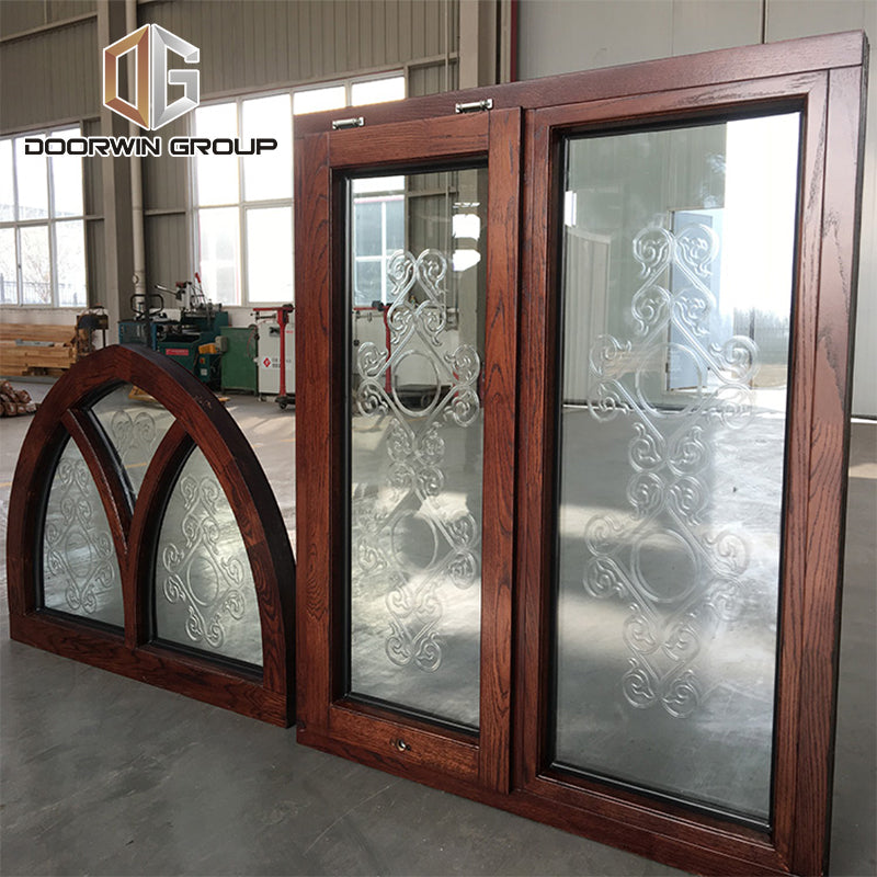 specialty shapes window-27 Fantastic arched oak wood window frame with carved glass