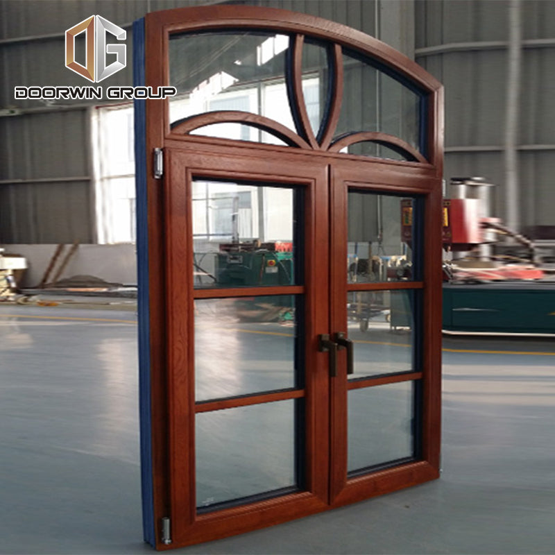 Arched thermal break aluminum window with oak wood cladding from inside, casement French window with grill design
