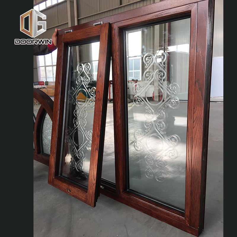 arched fixed transom windows with carved glass