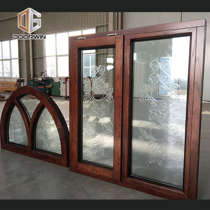 Arched fixed transom with carved glass