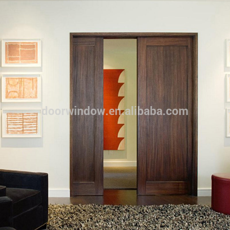 luxury interior wood door concealing sliding pocket door with invisible track by Doorwin