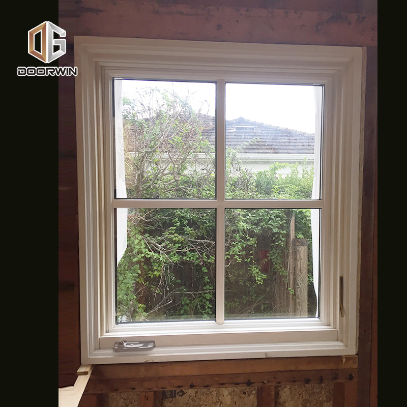 white solid wood crank open window
