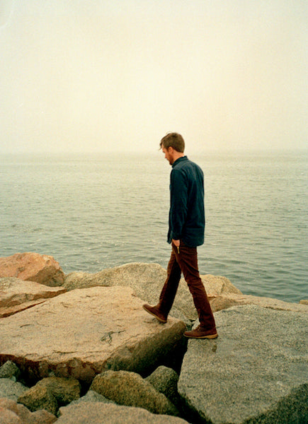 Joe Conway, author of the Wool, Wood, and Whiskey blog, walks along the Maine coast. Photograph by Mark Yaggie.