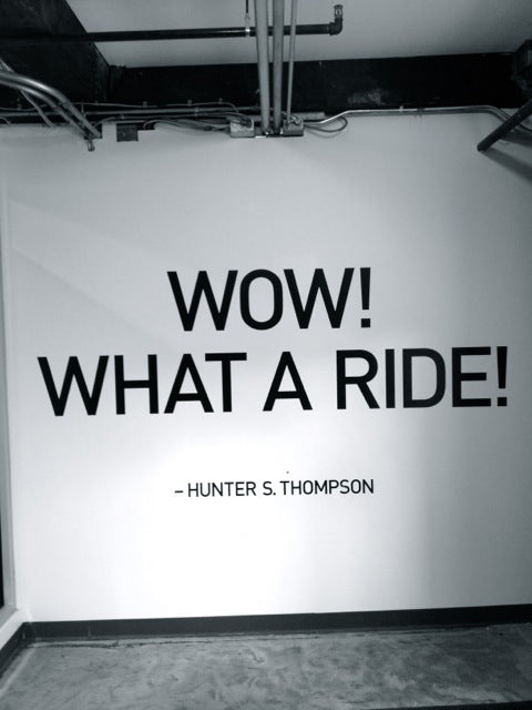 "Hunter S. Thompson's ""Wow! What a ride!"" quote on the wall in Magianero Cafe."