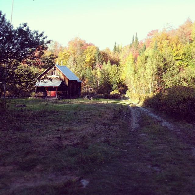 A hunting cabin in Hardwick, Vermont surrounded by fall foliage.