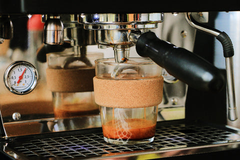 reusable coffee cup on an espresso machine