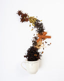 Chai ingredients pouring into mug